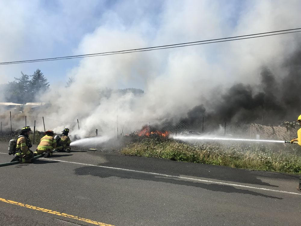 Photos courtesy Sheridan/Southwest Polk/West Valley fire districts##A storage yard and outbuildings burned along Highway 18 in Grand Ronde Wednesday afternoon.