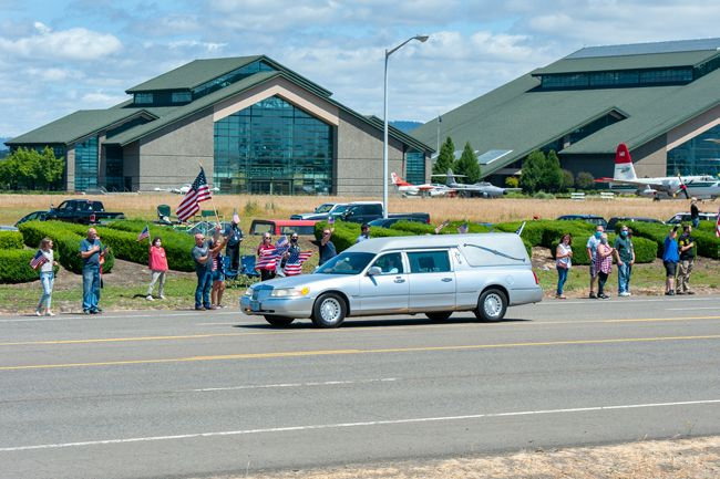 Rusty Rae/News-Register##A Macy and Son Funeral Director's hearse passes by hundreds of supporters on Highway 18 with the body of Oregon Army National Guard soldier Pfc. Alexander Blake Klass of Willamina Thursday afternoon
