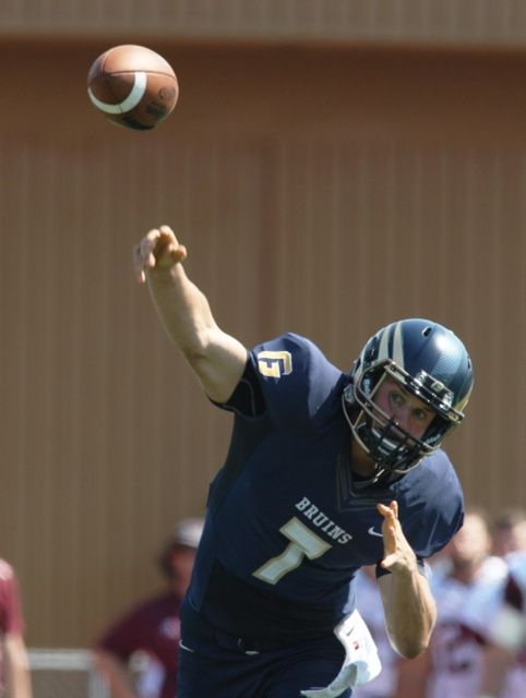 Rockne Roll/News-Register##George Fox quarterback Grant Schroeder completed 31 of 50 passes for 425 yards and three touchdowns in the Bruins  39-35 victory over Redlands Saturday afternoon.