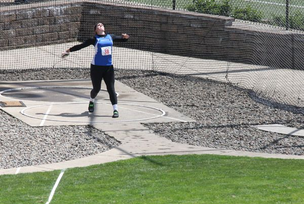 Rockne Roll/News-Register##Lindsay McShane of Amity attempts a discus throw Thursday at Hayward Field in Eugene.