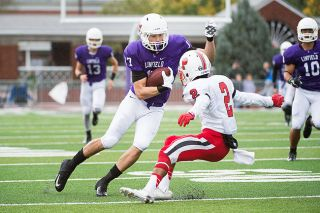 Marcus Larson/News-Register##Linfield sophomore cornerback Cory Stowell (17) jukes Pacific wide receiver Jojuan Thomason (2) as Stowell returned a pass off a fake punt 66 yards for a touchdown against the Boxers.