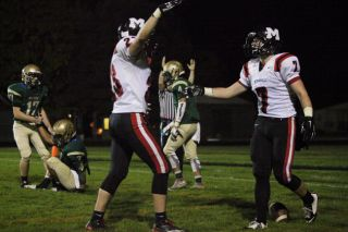 Rockne Roll/News-Register##Jesse Medley (7) and Justin Trimble (23) celebrate Medley's second receiving touchdown of the night Friday evening in McMinnville s 28-7 victory over McKay.