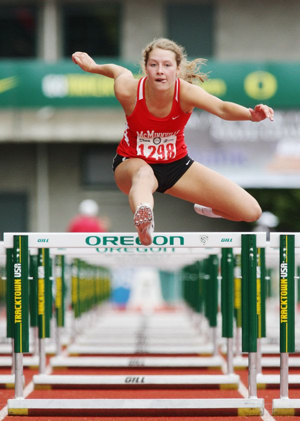 Rockne Roll/News-Register##McMinnville senior Montanna Gubrud clears a hurdle in her preliminary heat of the 6A girls  100-meter hurdles Friday at the OSAA State Track and Field Championships.