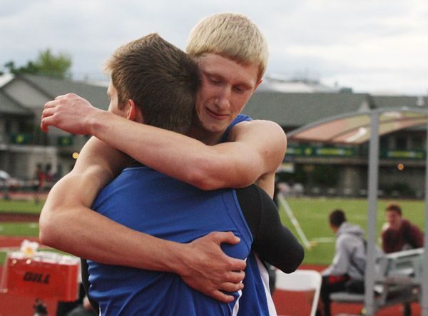 Rockne Roll/News-Register##Amity senior Lance Nelson (right) embraces his younger brother, sophomore Jaycen Nelson, after the brothers  1-2 finish in the 3A boys  high jump competition at the OSAA State Track and Field Championships Friday.
