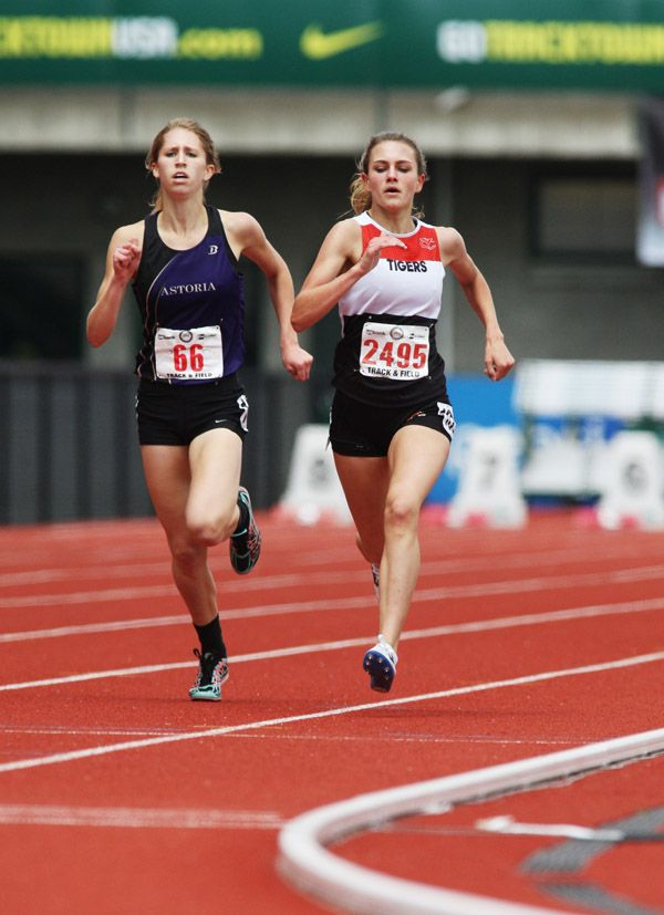 Rockne Roll/News-Register##Perrin Xthona of Yamhill-Carlton (right) and Kaylee Mitchell of Astoria race down the stretch of the 4A girls  1,500 meters Saturday. Xthona (4:43.01) edged out Mitchell (4:43.51) to win the 4A state title.