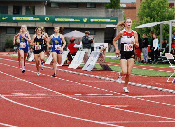 Rockne Roll/News-Register##Yamhill-Carlton senior Perrin Xthona (right) pulls away from the field to win the 4A girls  3,000 meters Friday morning at Hayward Field in Eugene.