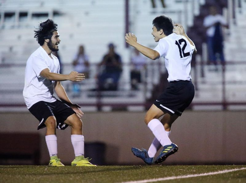 Rockne Roll/News-Register##Dayton s Enrique Rubio, right, celebrates his game-winning goal with Cristhian Garcia in the Pirates  Class 3A/2A/1A Special District Two match against Western Mennonite/Perrydale at Gubser Field in Dayton Wednesday, Sept. 27.