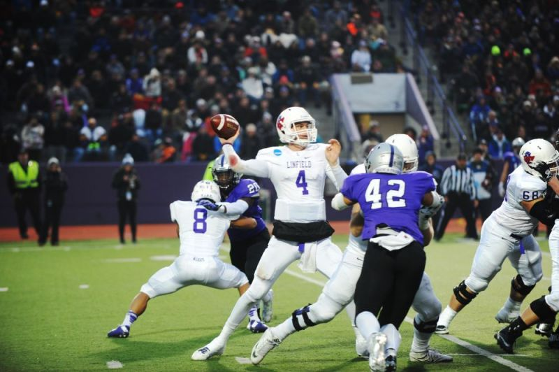 Courtesy of Rusty Rae##Linfield quarterback Tom Knecht completed 14 of 28 passes for 117 yards, with two interceptions, during the Wildcats  38-17 loss to St. Thomas in the NCAA Division III football semifinals Saturday.