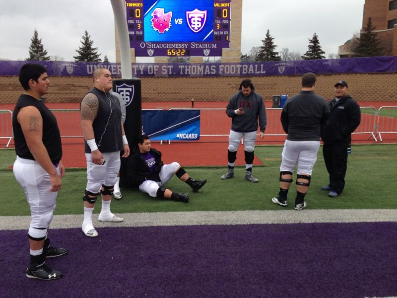 Courtesy of Rusty Rae##Linfield linemen walk around Palmer Field in O Shaughnessy Stadium before their NCAA Division III semifinal game against St. Thomas.