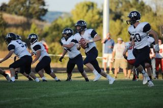 Rusty Rae/News-Register## Amity QB Jake Deboff (11) takes off on a run. Blocking for him are Damian Stewart (20), Vincent Ruiz (64), Sean Vincent (51) and Ezra Pacheco (50)