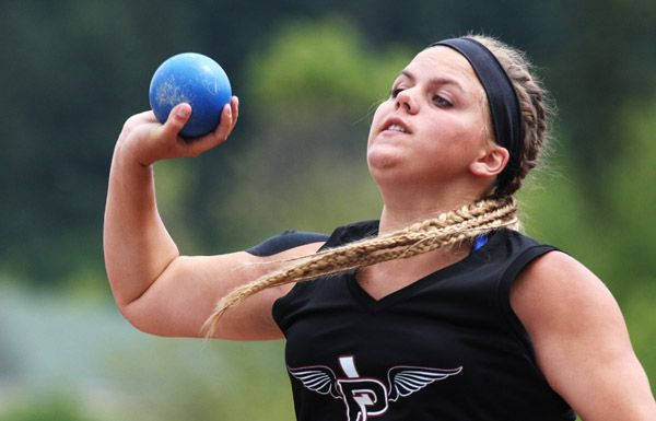 Rockne Roll/News-Register##Perrydale senior Sarah Clark competes in the 1A girls  shot put during the OSAA State Track and Field Championships Friday at Hayward Field. Clark finished eighth overall with a mark of 31 feet, 3 1/2 inches.