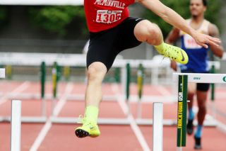 Rockne Roll/News-Register##McMinnville senior Tanner Scanlon knocks down a hurdle during his school record-setting performance (38.86 seconds) in the Class 6A boys  300-meter hurdles final Saturday.