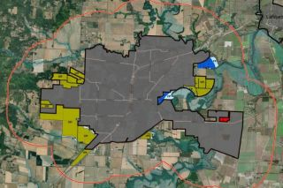 City of McMinnville map##Draft UGB Proposal as of Oct. 13: yellow shade represents added land for Urban Holding; red for commercial; dark blue for industrial; and light blue is floodplain. The red line indicates the area one mile from the current UGB, but only shaded land is proposed to be added.