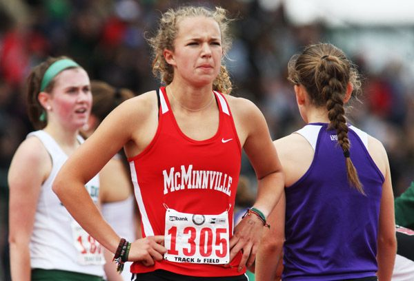 Rockne Roll/News-Register##McMinnville senior Whitney Rich looks at her time following the 6A girls  1,500 final at the OSAA State Track and Field Championships at Hayward Field Saturday. Rich ran a school- and personal-record time of 4:37.76.