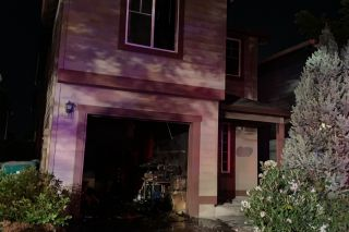 Tualatin Valley Fire & Rescue photo##Five adults escaped a burning Newberg residence late Sunday night.