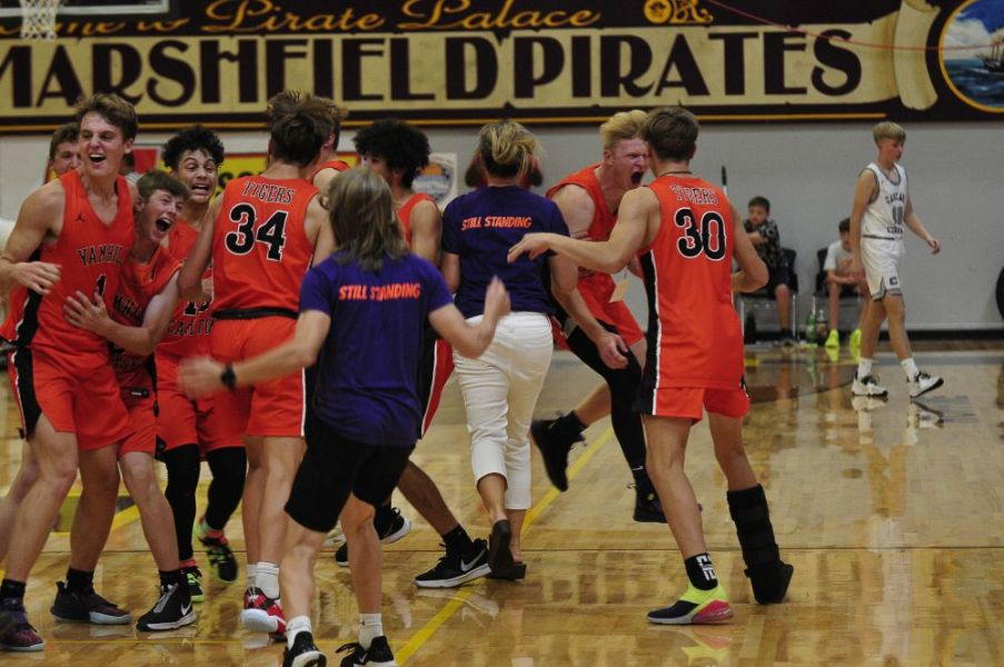 Photo courtesy John Gunther/The World## Yamhill-Carlton's players and coaches celebrate after time runs out in the championship game against Cascade Christian.