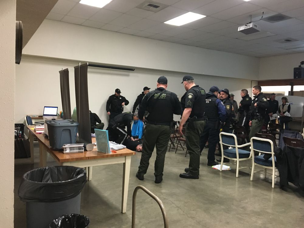 Pamela Stringer/submitted photo##The Burger King stabbing suspect is taken into custody in the Yamhill County Public Works Auditorium.