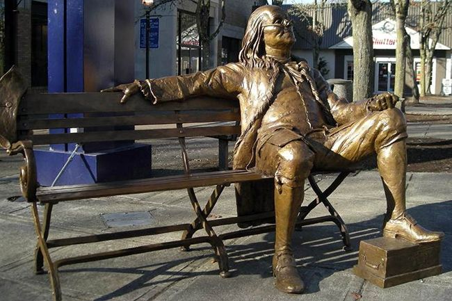 Photo courtesy McMinnville Downtown Association##The bench at the corner of Third and Davis streets in downtown McMinnville is a popular resting spot for pedestrians and Benjamin Franklin.