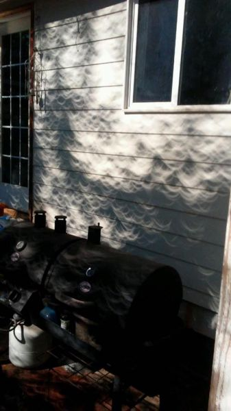 Submitted by Leona Cliff Atkinson##Shadows on my daughter s house on Elmwood in McMinnville after totality.
