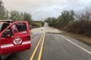 Submitted photo##West Valley firefighters rescued a driver stuck in about 12 inches of water flooding Southwest Bellevue Highway Monday morning.
