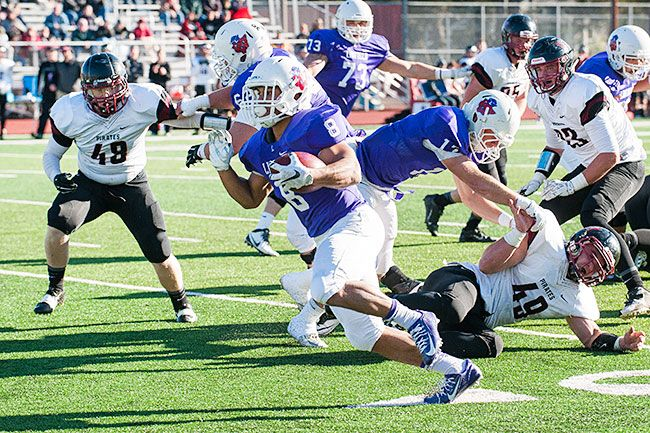 Marcus Larson/News-Register##Linfield s Spencer Payne rushed for 139 yards.