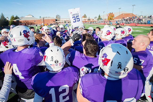 Marcus Larson/News-Register##The Linfield Wildcats celebrate their victory over Whitworth in the first round of the playoffs.