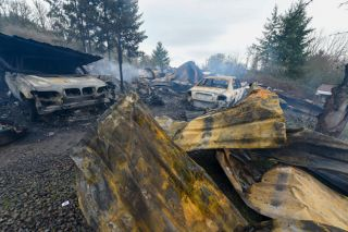 Rusty Rae / News-Register##The early morning fire burned several vehicles, as well as two mobile homes.
