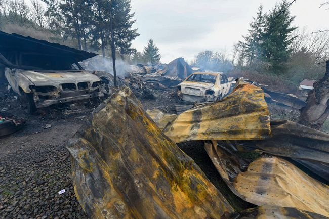Rusty Rae/News-Register##Wednesday morning s fire off Highway 233 resulted in a massive amount of damage.