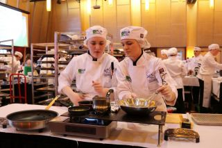 Submitted photo##Mac High ProStart team members Heidi Janke and Kaylyn Clevenger work on their dishes for the state culinary competition.