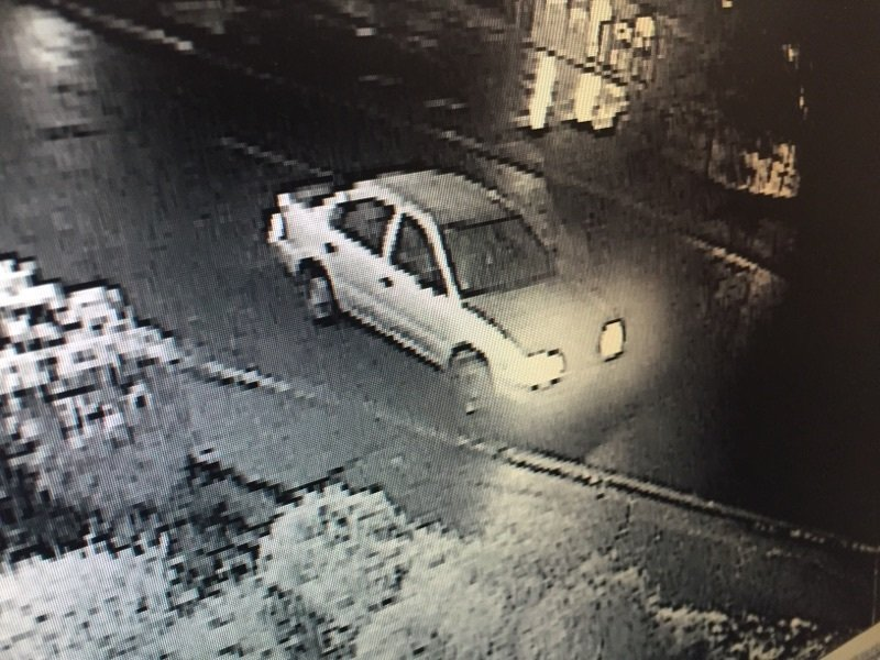Submitted photos##Surveillence photo shows the car in which authorities think the suspect fled.