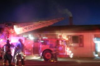 Submitted photo##Sheridan firefighters work at Sea Reach Friday evening. The fire was reported about 8:30 p.m.