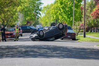 Rusty Rae/News-Register##A Honda CRV rolled onto its top as the result of a three-vehicle crash at Northeast Ninth and Davis streets in McMinnville Friday morning.